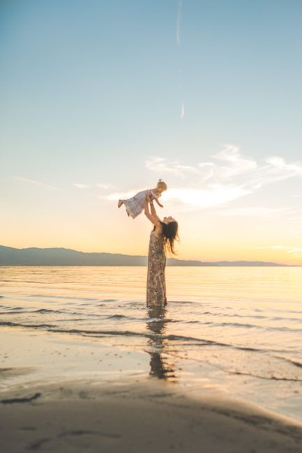 mom throwing her baby girl in air | jacksonville family photographer